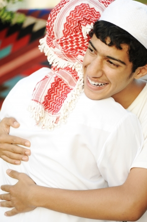 Friendly hug, two arabic guys photo