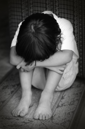 neglect: Abused child Stock Photo