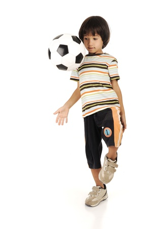 Little boy playing football isolated on white background photo