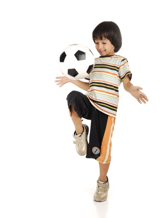 one little boy: Little boy playing football isolated on white background Stock Photo