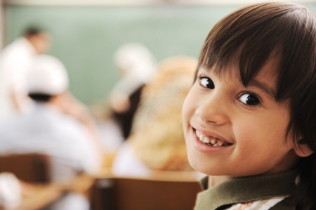 small girl: Children at school classroom