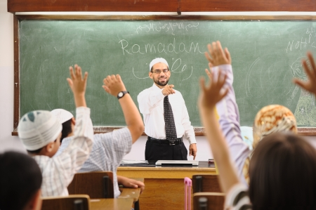 middle school: Muslim arabic children with teacher at school Stock Photo