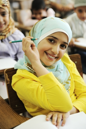 girl notebook: Children at school classroom