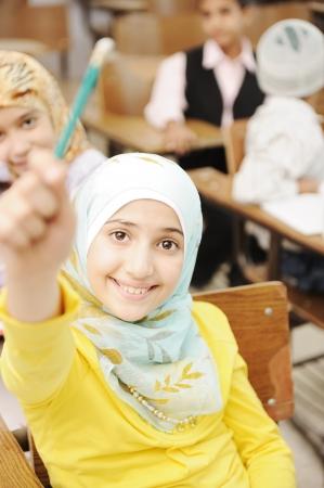 arabic boy: Children at school classroom