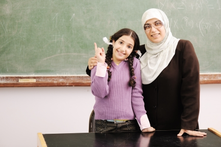 learning arabic: Teacher and little girl together