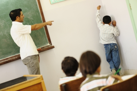 punish: Children at school classroom