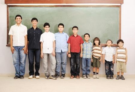 elementary age boys: Children at school classroom