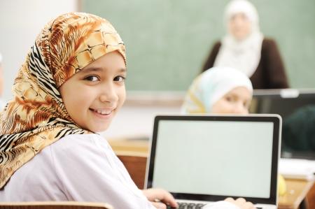 boy arabic: Children at school classroom