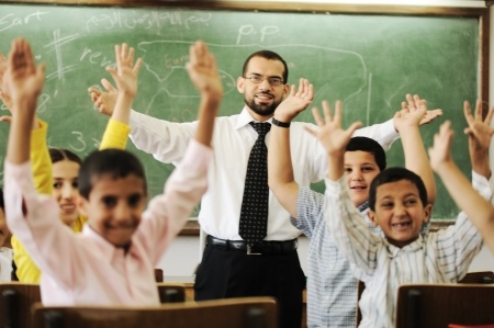 learning arabic: Teacher with boys and girls in school