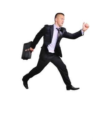 Full length portrait of a businessman running away against white background photo