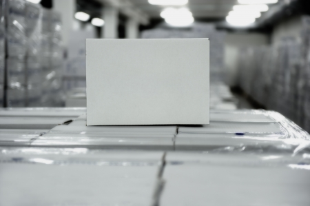 Carton box on top of boxes in warehouse photo