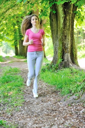 Attractive girl running outdoors photo
