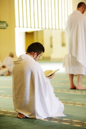 Muslim wearing ihram clothes and ready for Hajj Stock Photo - 14432710
