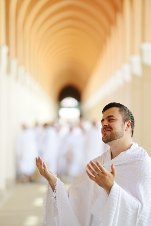 Muslim wearing ihram clothes and ready for Hajj Stock Photo - 14432482