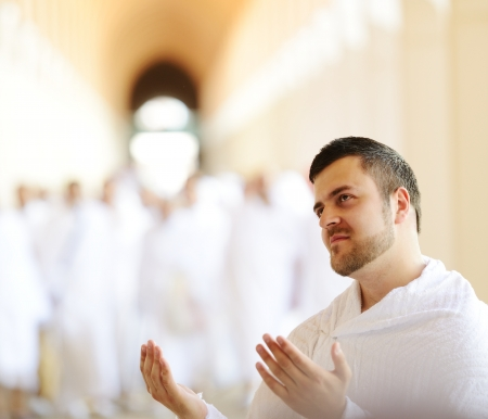 Muslim wearing ihram clothes and ready for Hajj photo