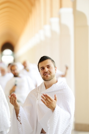 Muslim wearing ihram clothes and ready for Hajj Stock Photo - 14432278