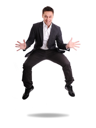 Full length of excited business man jumping photo