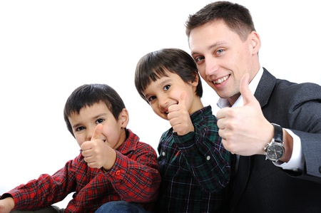 Portrait of happy father and two sons with thumbs up photo