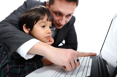 two parents: Father and son using laptop