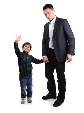 Son and father, child and adult standing, full body photo