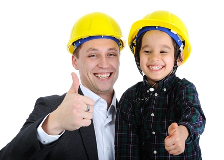 Father and son as workers with thumb up photo