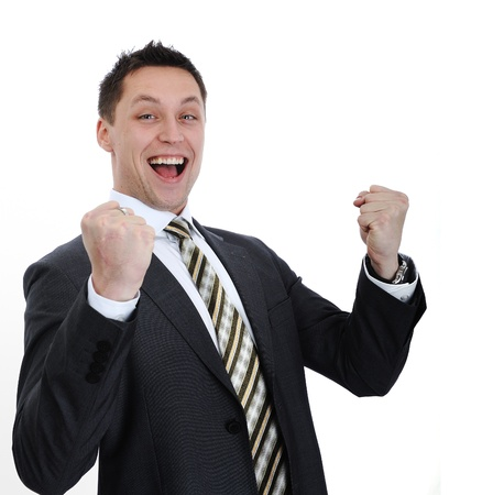 Businessman lifting arms in excitement photo