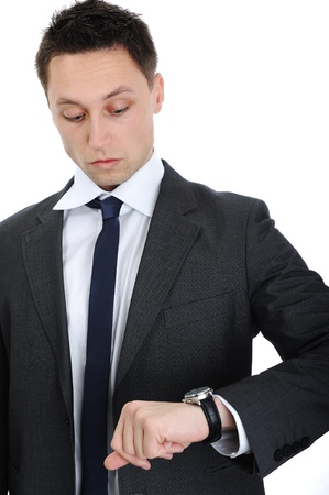Businessman looking on his watch photo