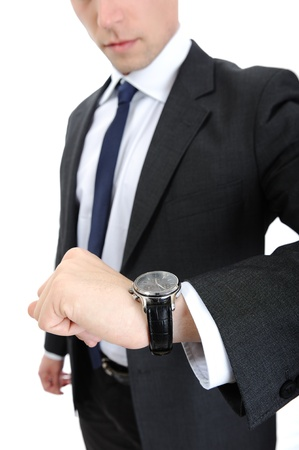 Business man looking on his watch photo