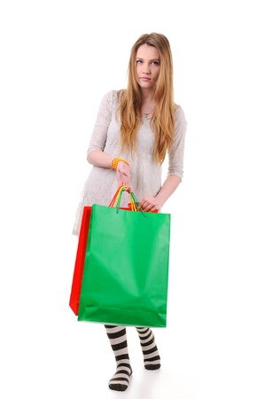 spending full: Cute teenage girl with shopping bags