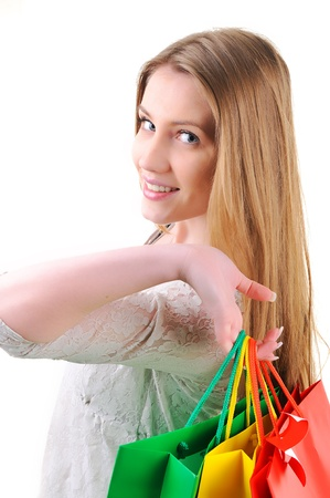 Closeup image of a teen girl holding shopping bags photo