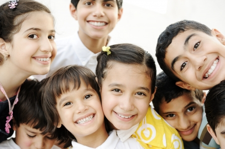 arabic man: Group of happy children