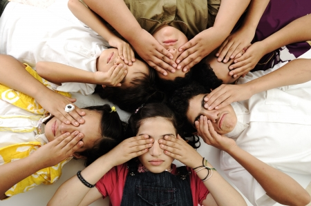 Group of happy children with closed eyes photo