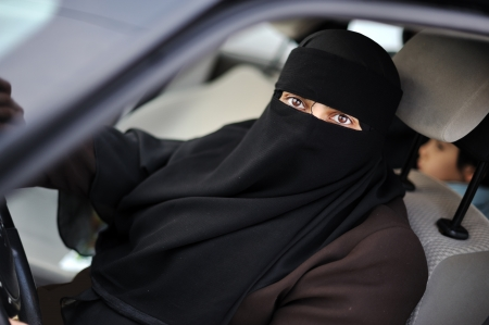 Muslim middle eastern female driver wearing veil photo