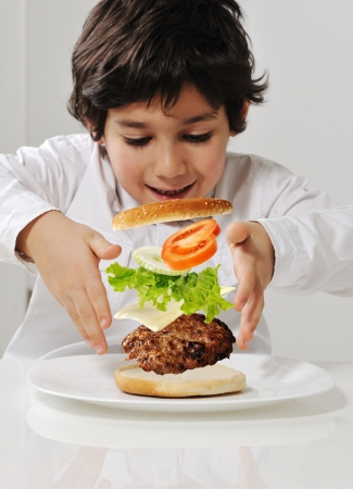 Kid making burger by himself photo