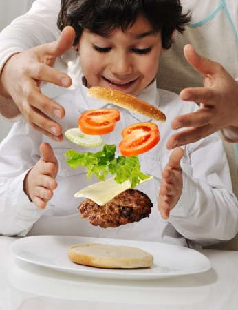 Mother and little boy with burger in hands photo