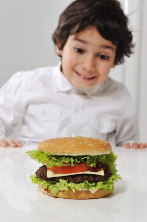 Little Arabic boy with burger photo
