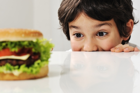 breakfast food: Boy and burger Stock Photo