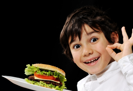 Kid serving burger Stock Photo