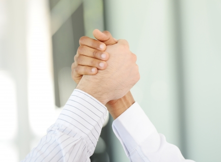 Successful business people hand shaking after great deal photo