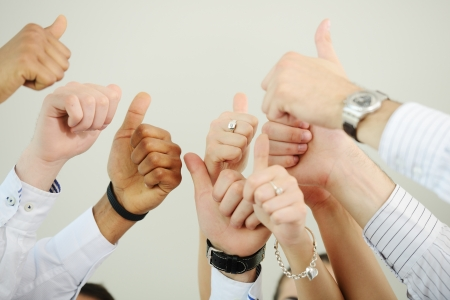 Successful business people with thumbs up photo