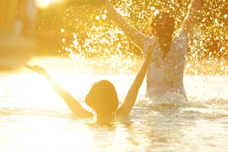 swimming silhouette: Happy children playing on hot summertime