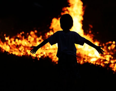 risk of war: Child on fire with wide open arms