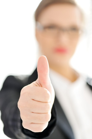 Young business woman with thumb up photo