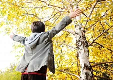 Happy kid in autumn park portrait Stock Photo - 15636110
