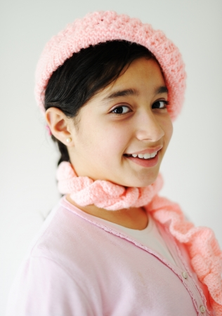 Cute teen girl with pink hat  photo