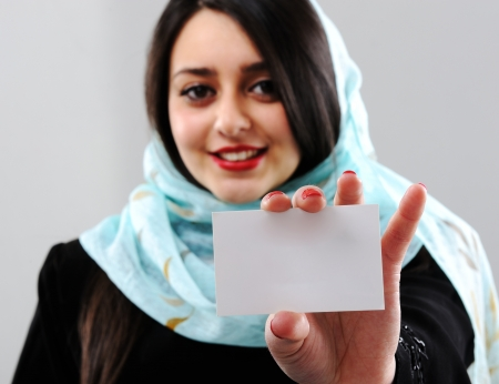 Arabic woman holding visit card with copy space Stock Photo - 16159423