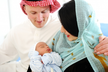 middle eastern ethnicity: Arabic Mother and Father with baby at home Stock Photo
