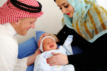 Arabic Mother and Father with baby at home photo