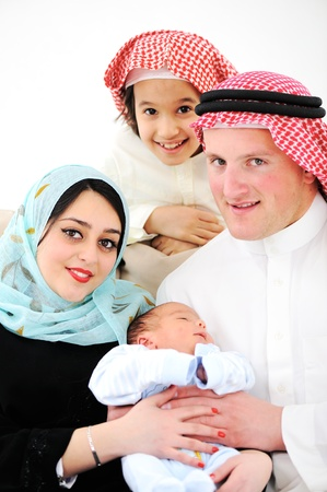 Portrait of Arabic family with new baby at home Stock Photo - 16160780