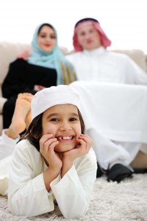 Happy Arabic family at home photo
